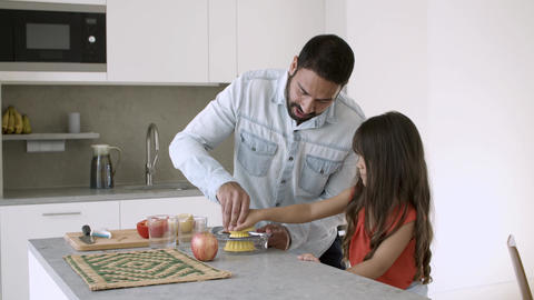 Young dad and daughter enjoying cooking Live Action