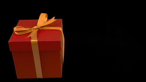 Red gift box with yellow gold ribbon bow rotate at transparent background alpha channel chroma key Live Action