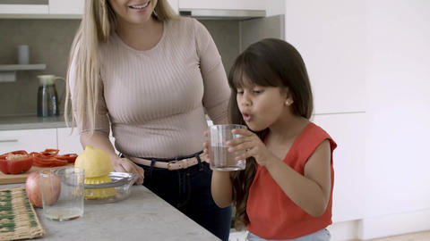 Funny little girl cooking with her mom Live Action