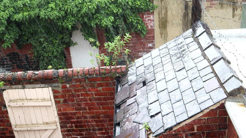 Heavy Summer Rain Falling On a Broken Slate Outhouse Roof In The United Kingdom Live Action
