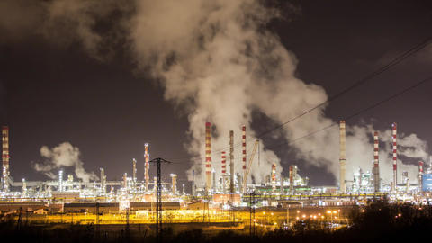 Petrochemical plant lit up at night Live Action