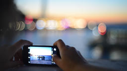 Tourist taking photograph 실사 촬영