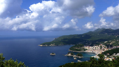 Panorama over the harbor Greek city of Parga with rocks and islands surrounding Footage