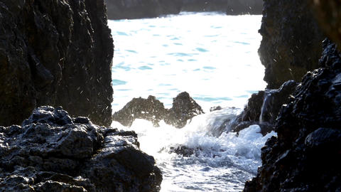 Splashes of water formed when waves break on the shore of steep boulders 81 Footage