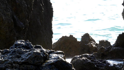 Splashes of water formed when waves break on the shore of steep boulders 81b Footage