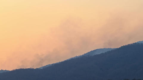 Timelapse wildfires in mountain.. Big wildfires and smoke in mountain forests Live Action