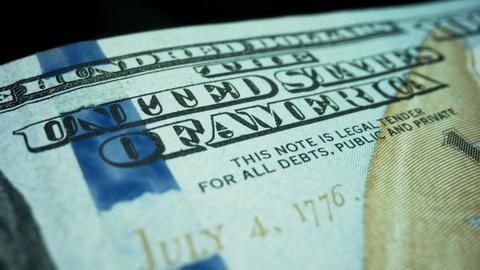 Cash money background. New one hundred dollar banknote on black background Live Action