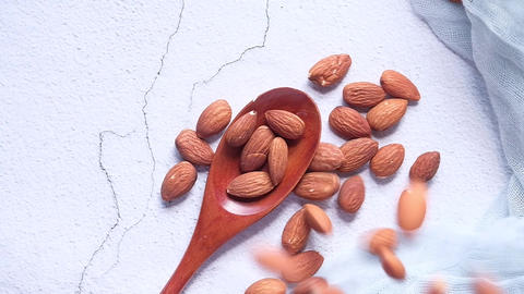 almond nut drops on spoon on white background Live Action