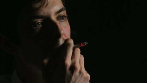 desperate man smoking: depression, fear, sadness, loneliness, dark Footage