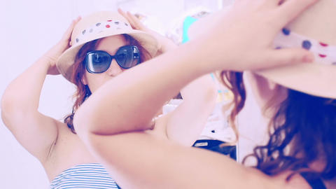 young woman is reflected in a mirror and wearing a hat: summer, beautiful, cute Footage