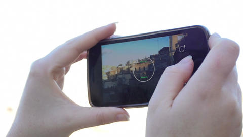 woman is taking pictures with the smartphone: tourist, tourism, Italy, Matera Footage