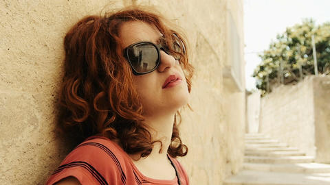 thoughtful woman portrait in a hot summer day: pensive red haired woman Live Action