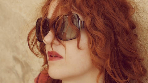 thoughtful red head woman with sunglasses Footage