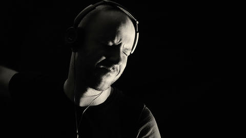 young man listening to music with headphones: rhythm, rock, fun, sound Footage