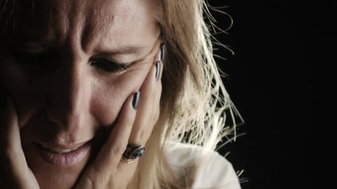 desperate blonde woman is thinking to her trouble: depression, loneliness Footage