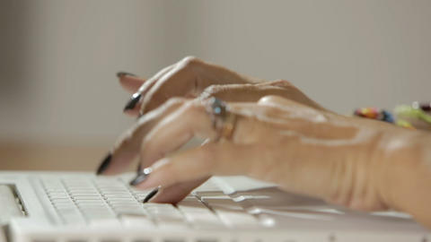 hands of woman typing on the keyboard of notebook, close up footage Footage