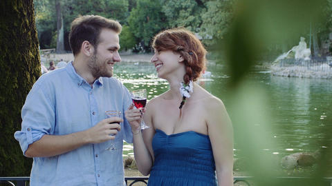 young man and young woman drinking wine in a romantic... Stock Video Footage