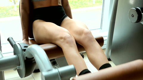 Girl trains the legs in the gym Footage