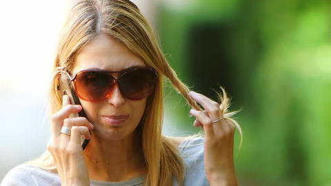 young blonde girl talking at the phone with sunglasses, mobile phone, smartphone Footage