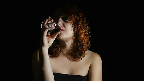 portrait of a woman tasting red wine and drinking Footage