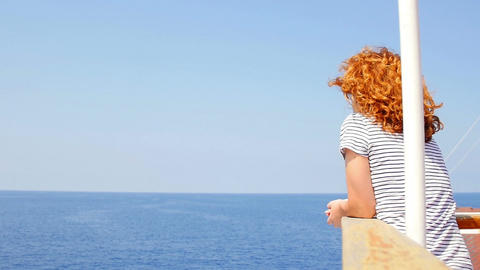 pensive woman looking the sea from a ship: summer, summertime, sunny day Footage