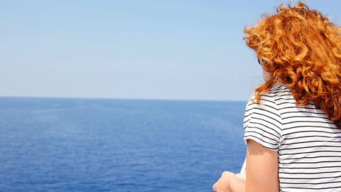thoughtful woman looking to the sea aboard of a ship: summer, wind, sun Footage
