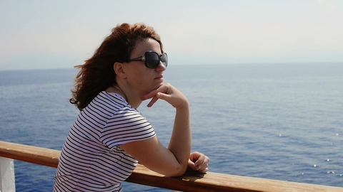 thoughtful woman on board of a ship: summer, sun, wind, pensive girl Footage