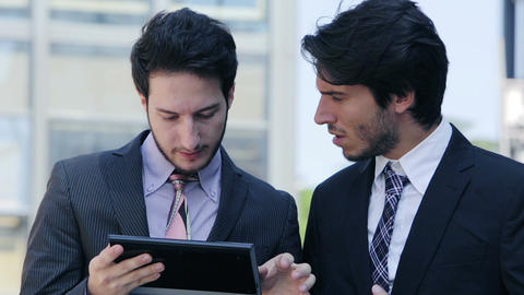 businesspeople going at work and using tablet and smartphone Footage