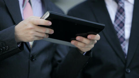 businessmen using mobile devices: tablet, phablet, smartphone Footage