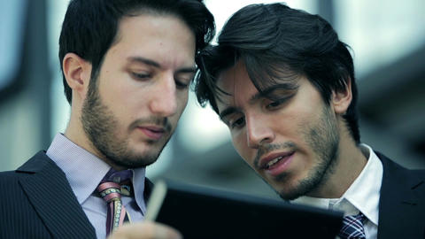 businesspeople at work with tablet and smartphone Footage