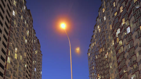 A street lamp illuminates the night city. Electricity consumption. street lamp on a pole glows Live Action