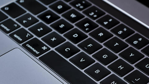 Gray laptop keyboard close up Live Action