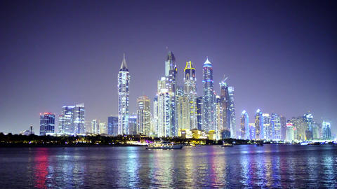 Real Time Dubai City at Night Reflected in Water Live Action