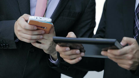 teamwork out of office with mobile devices like smartphone and tablet Footage