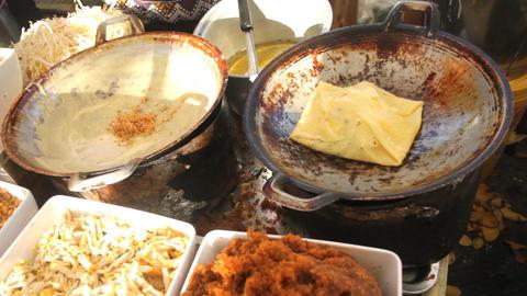 Preparing Thai Food , Thai Crepes, Kanom Buang Yuan Footage