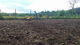 Man plowing with cultivator Footage