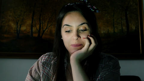 smiling young woman is chatting on the internet with webcam in the night Footage
