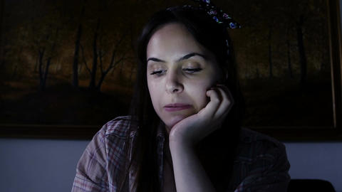 young woman talking with someone via video chat using webcam and notebook Footage
