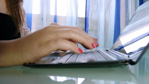 slow motion of hands of woman typing on a laptop keyboard Footage