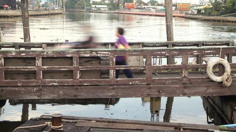 People Walking On Wooden Bridge Footage