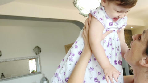 mother loving her child: hugs, games, tenderness in a lovely family Footage