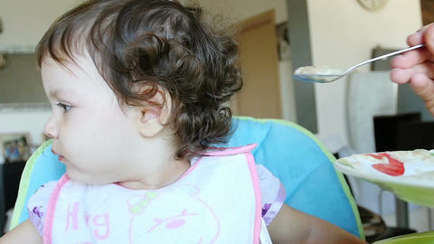 little girl refuse to eat baby food Footage