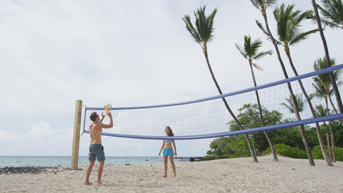 Friends playing beach volleyball - active lifestyle Live Action