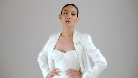 Beautiful modern look Asian businesswoman posing and looking at camera Live Action