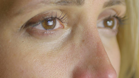 closeup portrait on beautiful eyes ready to cry: sad woman Footage