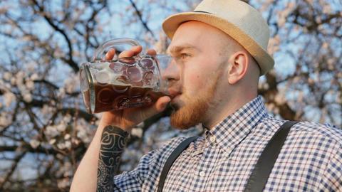 Tasty Beer Lover. Outdoors Footage