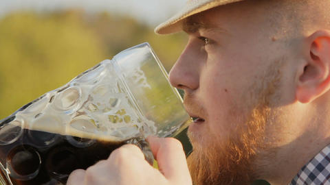 Portrait of a man, beer lover in nature on a sunny day Footage