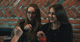 Women at bar 4k video. Female girls friends talking fun cafe Footage