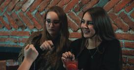 Women at bar 4k video. Female girls friends talking fun cafe Footage
