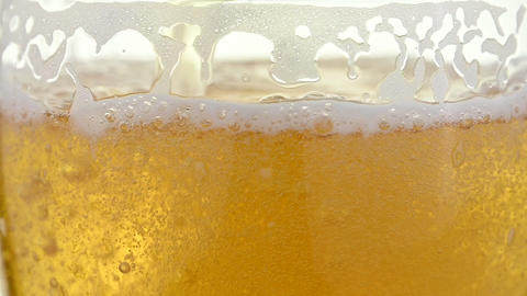 Close up background of pouring lager beer in glass Live Action
